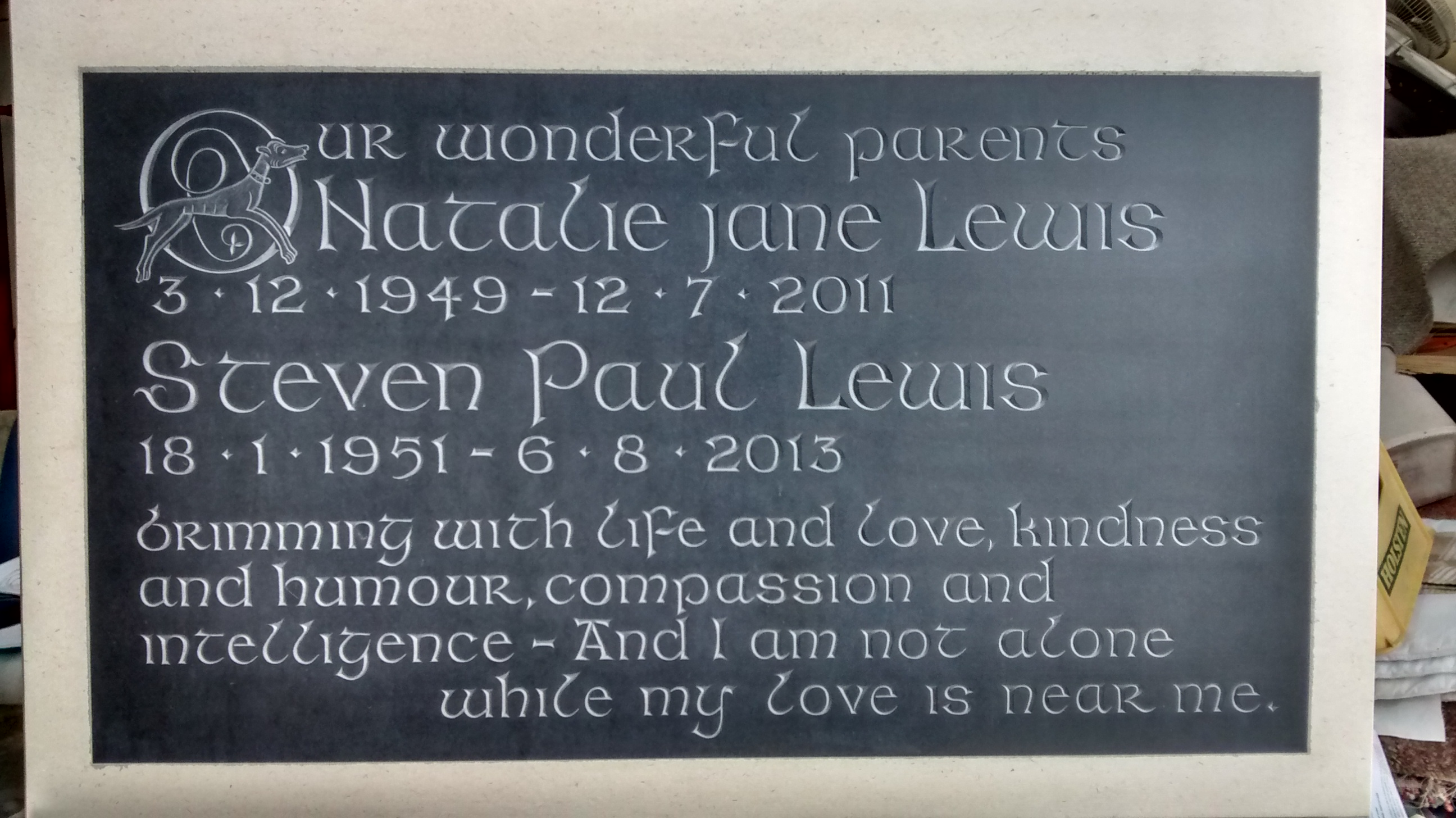 Welsh slate plaque set in to the face of a Portland stone tablet